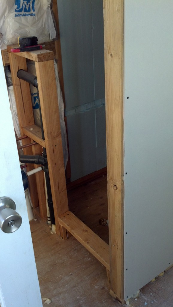 I added the step into the shower that will help keep the water contained.  I almost forgot it! :)