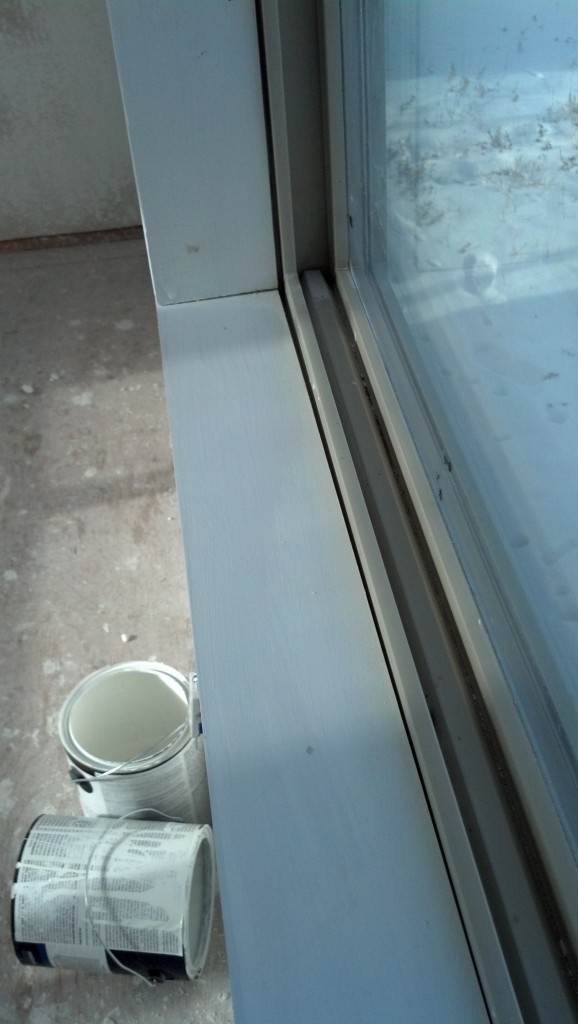 And I got to the windoows, all the gaps in the trim got a paintable caulk applied.  Here is the before.