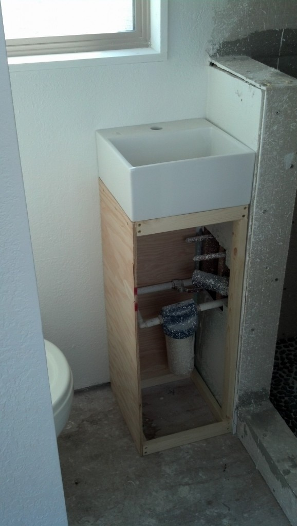 and my bathroom unit.  This filter filters all of the water that comes into the house.  I like how this looks and I love the sink! :) (I wasn't going to do this originally, I was planning on a sink share with the kitchen.  I'm glad I added this though!