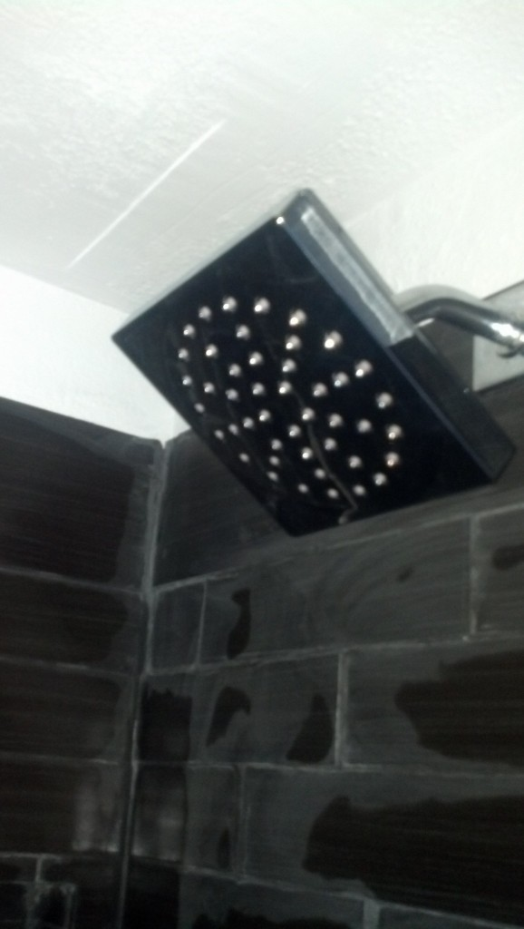 And the shower head, which is neat, I like the geometric shapes