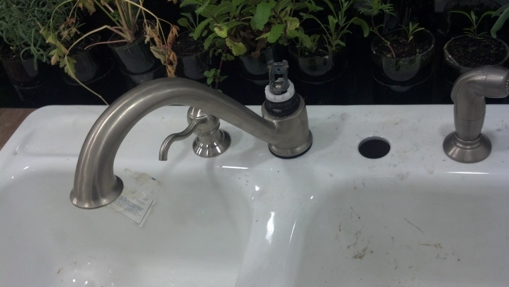 I say nearly because the sink is having a little issue.  It is a recycled faucet and as such has a minor issue, a part needs replaced to get rid of a leak.. There is an extra hole that I was going to put an instant hot water fixture in for my french press, I think the water heater will work for that though honestly, it gets HOT!  Now I will just plug the hole.