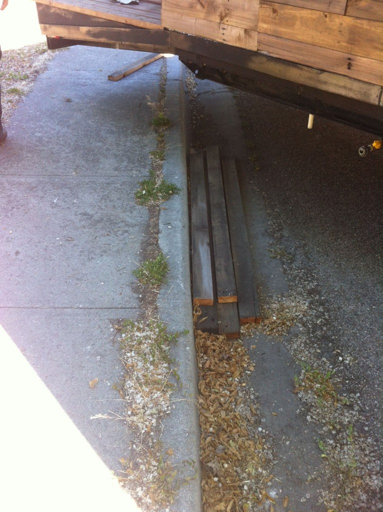 We took some extra pieces of wood to make 'ramps' over the curb