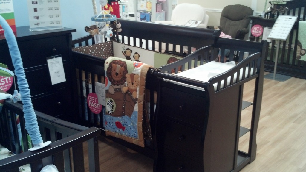 I am thinking this is the crib set-up I will be going for, its just about the same size as Denny's box so it will sit right where that is.  It's kinda nice that it has it's own storage and since I don't have much free open space the changing area is pretty important.  By that time Denny will be all set to just be left out.