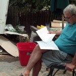The red bucket in the background is the 'filter'.  Dad is reviewing som drawings fro James's projects.