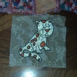 And mom finished the last baby quilt block!  its an adorable satin leopard.  I think i am missing one from the line-up, either the hippo or the rhino, I'll have to do an update on that soon. :)