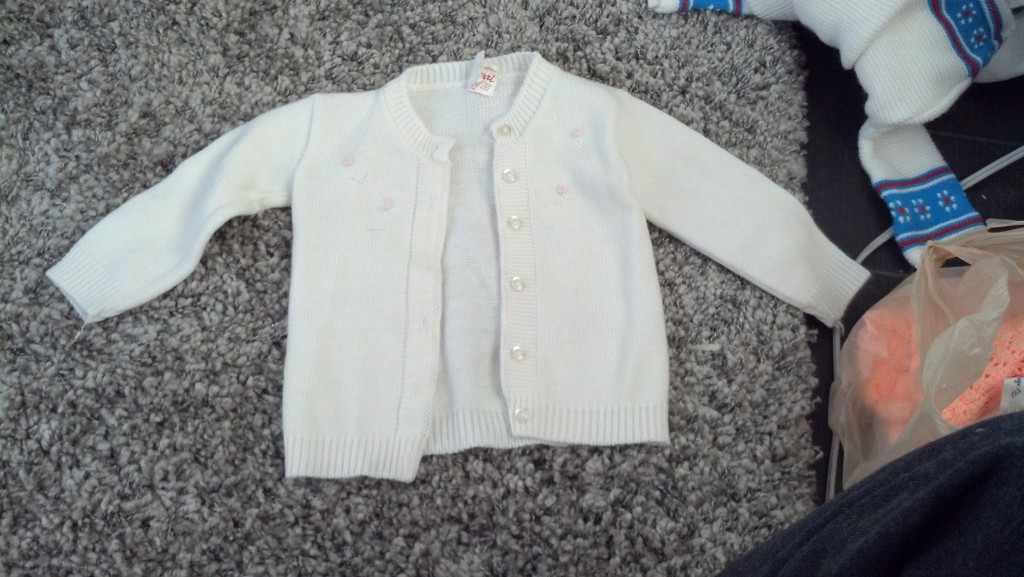 Becca gave me some of her baby cloths!  The are freaking adorable!  This one is my very favorite!  These blonged to Becca when she was a baby, since they are having a boy she is letting me use the her little girl cloths, this sweater totally looks like something a 'Nora' would wear, huh? :) That is the name of the day!