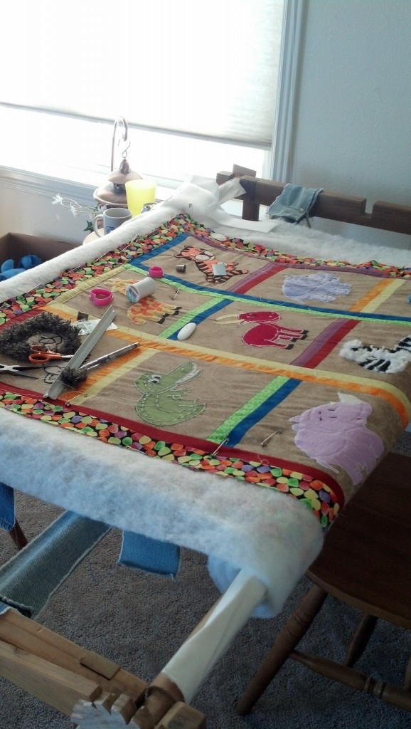 Mom finished the top of MiniMiller's quilt!  It's adorable!
