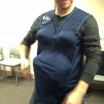 James tried on the sympothy belly at Lamaze, it was pretty funny, my one request was for him to wear it and try to put his shoes on, that is SO much harder around a basketball in your belly!