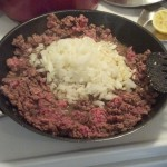 Brown some hamburger, add an onion and some garlic to cook down