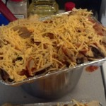 Now I call it enchilada casserole :)  I stuck it in the oven to bake on 350 until the cheese was melted and bubbly