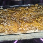 then layer it over the hashbrowns, sprinkle with a little more cheese and crushed ritz crackers, bake until browned and melty