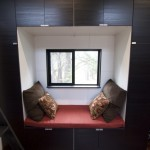 AND a cozy reading nook next to the double desk area, seriously you guys fit everything in!