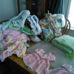 And this is all the projects mom has been doing for MiniM!  The green things are padding for the co-sleeper and all the blankets are swaddles and misc other items.  ANd her two baby quilts.