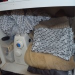 the lower cabinet houses my sewing machine, fabric, winter curtains and extra sheets/towels