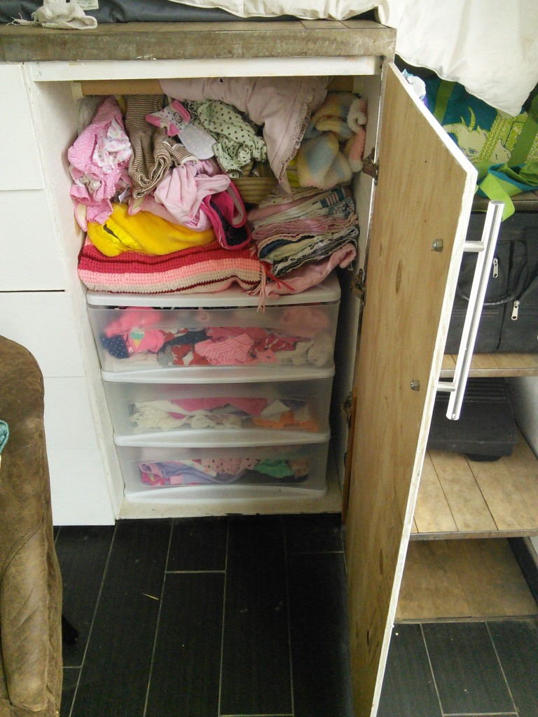 We will start with her clothes, Hazels has a rubbermaid set of drawers where her clothes are organized by size she has a lot of really cute hand-me-down clothes thanks to Alina, she wouldn't look cute without her!  On top of her clothes are all of her blankets and swaddles.