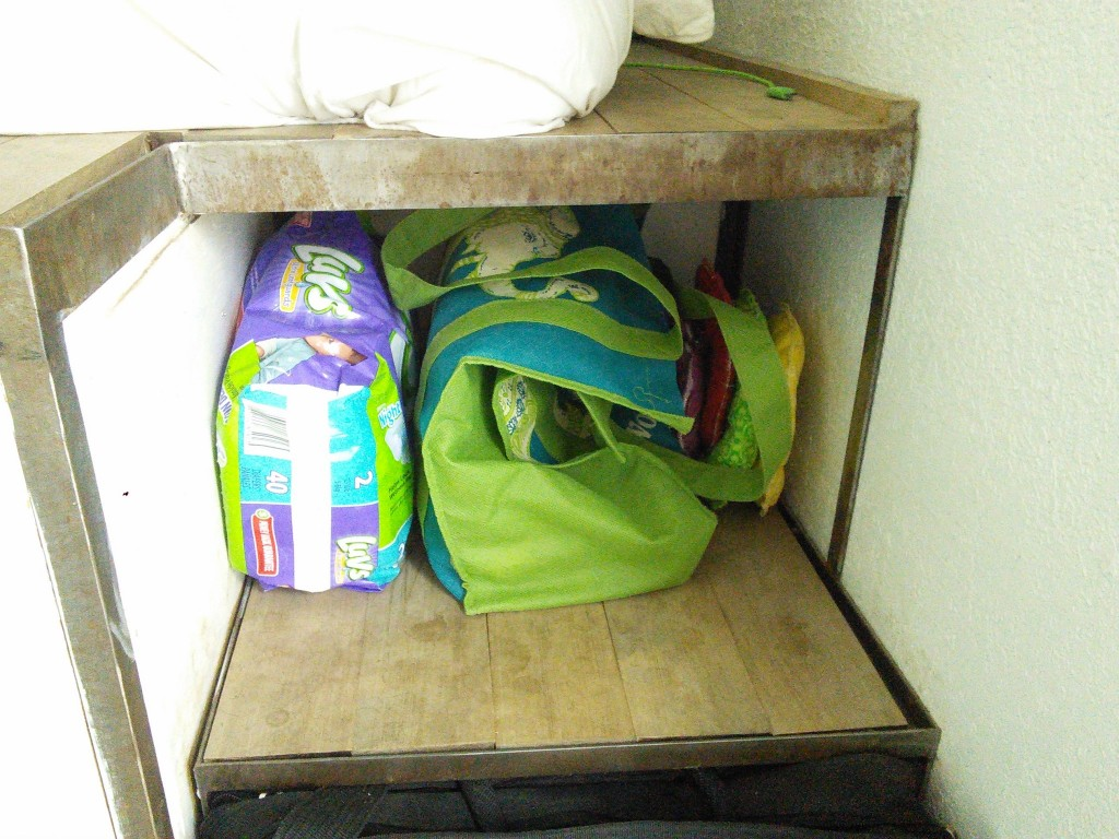 She does use a disposable diaper at night (lets me sleep a bit better whish iss importatnt too!) so I keep a pack of those around and store them with the diaper bag in the top step so it is handy to grab on my way out the door!