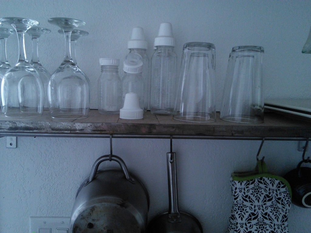 She has some glass bottles on the shelf right next to our cups...