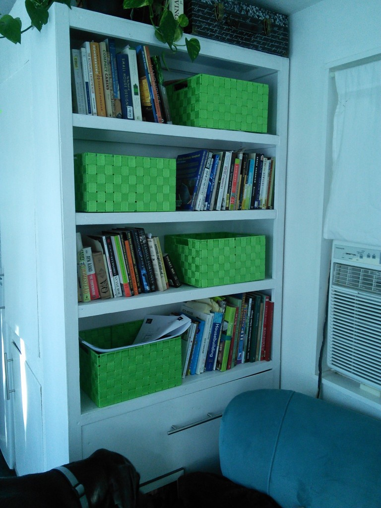 Since this happened though, I can give you a preview of the other housework I've been working on over the weekend, the media center is now just a bookshelf, I bought some chartreuse baskets to keep Hazel's toys in and added an extra bookshelf where the TV was.