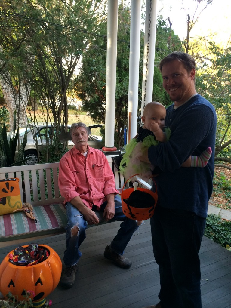 Our first trick or treat!  That creepy guy was debating scaring the hell out of all of us, he had the power to completely ruin Halloween for Hazelnut, he chose nice.