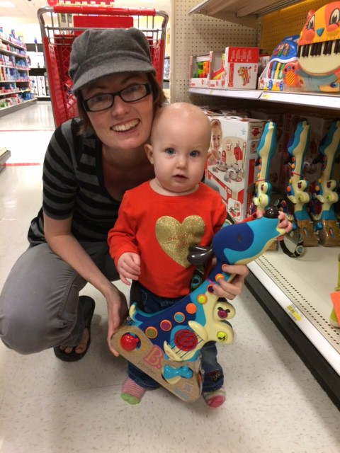 Rockin out with the dog guitar, sometimes playing with toys at the store is just as much fun as owning them ourself :)