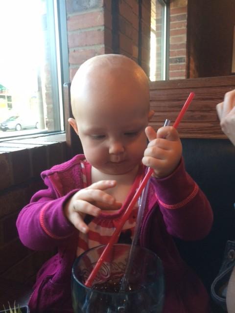 Straws are her new favorite splash tools...