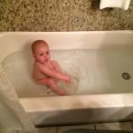 Her first real bath tub bath, she thinks its a pool!