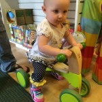 Playing with her new favorite bike at the toy store in Bend!