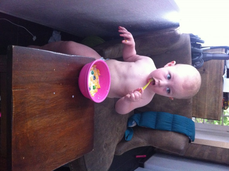 She manages to stay cleaner than if her dad feeds her! :)
