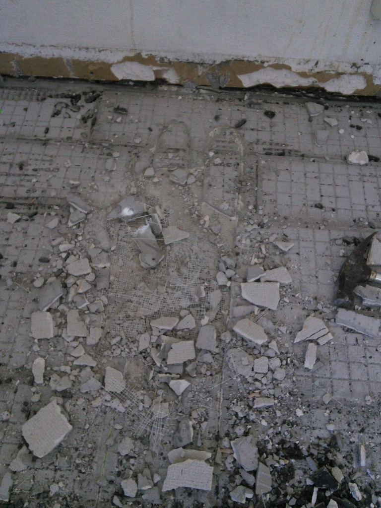 the sub tile floor wasn't so easily removed, especially with all the wires holding it together...