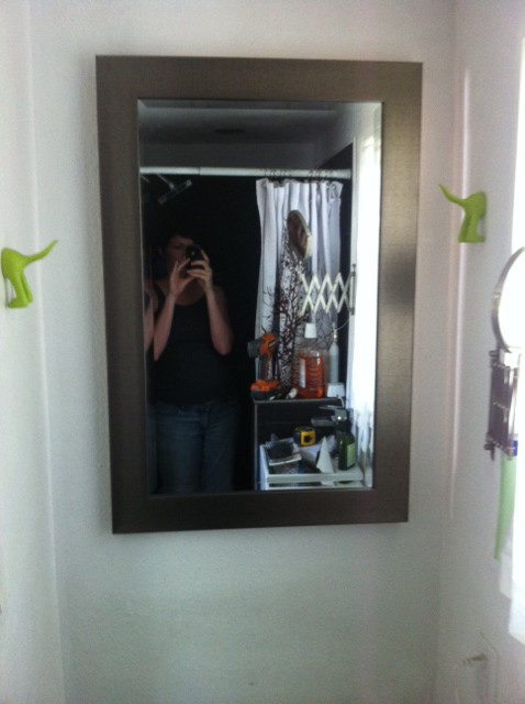Oh, and I made a medicine cabinet, well started it... this is wwhere the window used to be in the bathroom, its sure weird to have a gull sized mirror again