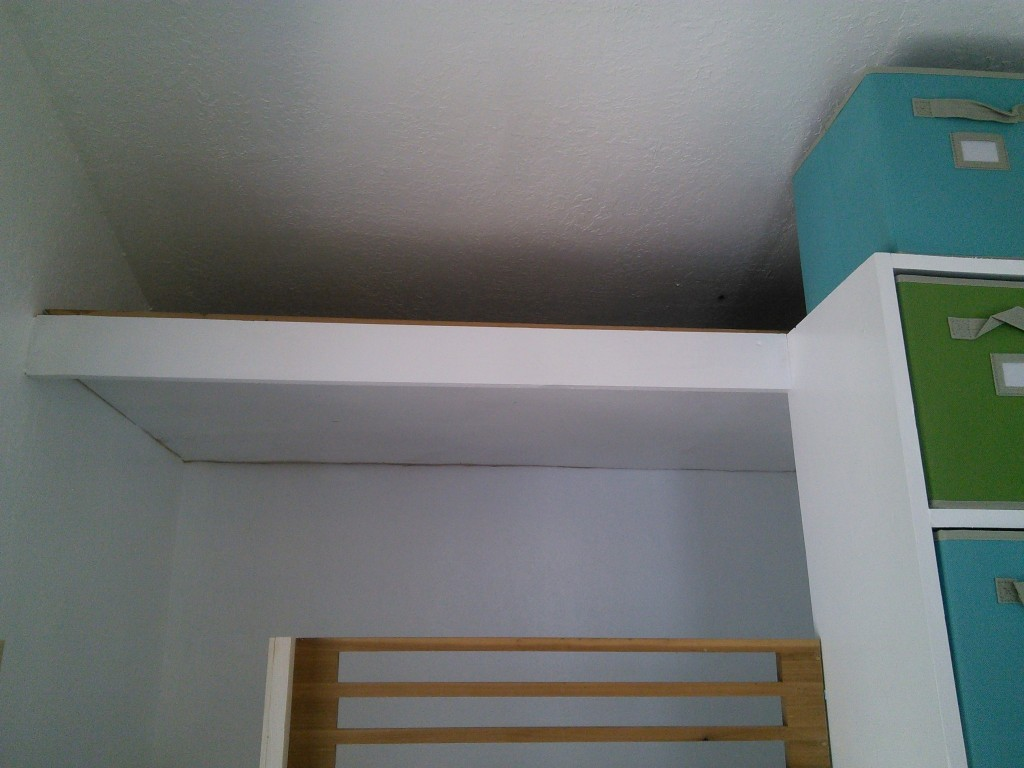 And that up above is storage for toys so that I can rotate them and keep things 'fresh' and new feeling.