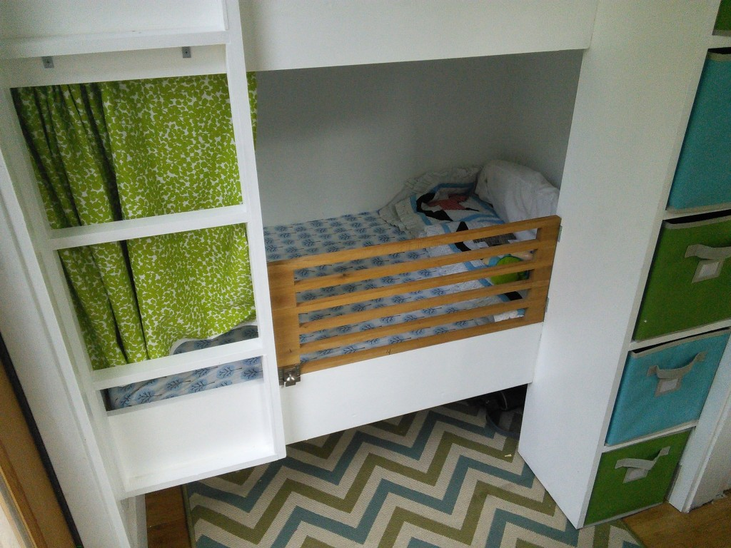 The bottom bunk with the curtains I made, I stuck with the green and teal doing green below, teal above, Hazel likes them both and has learned already to climb the ladder to the top bunk (scary, I thought it would be a long while still!)  She just can't go down...