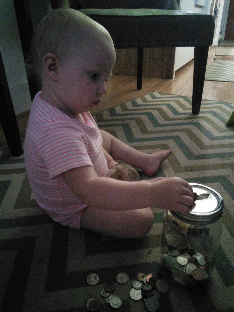 She SORTA started getting the difference between penny, nickle, dime quarter... but mostly just played with the 'moony'