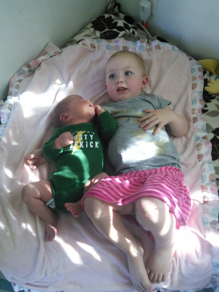 She LOVES getting to 'hold' the baby :)