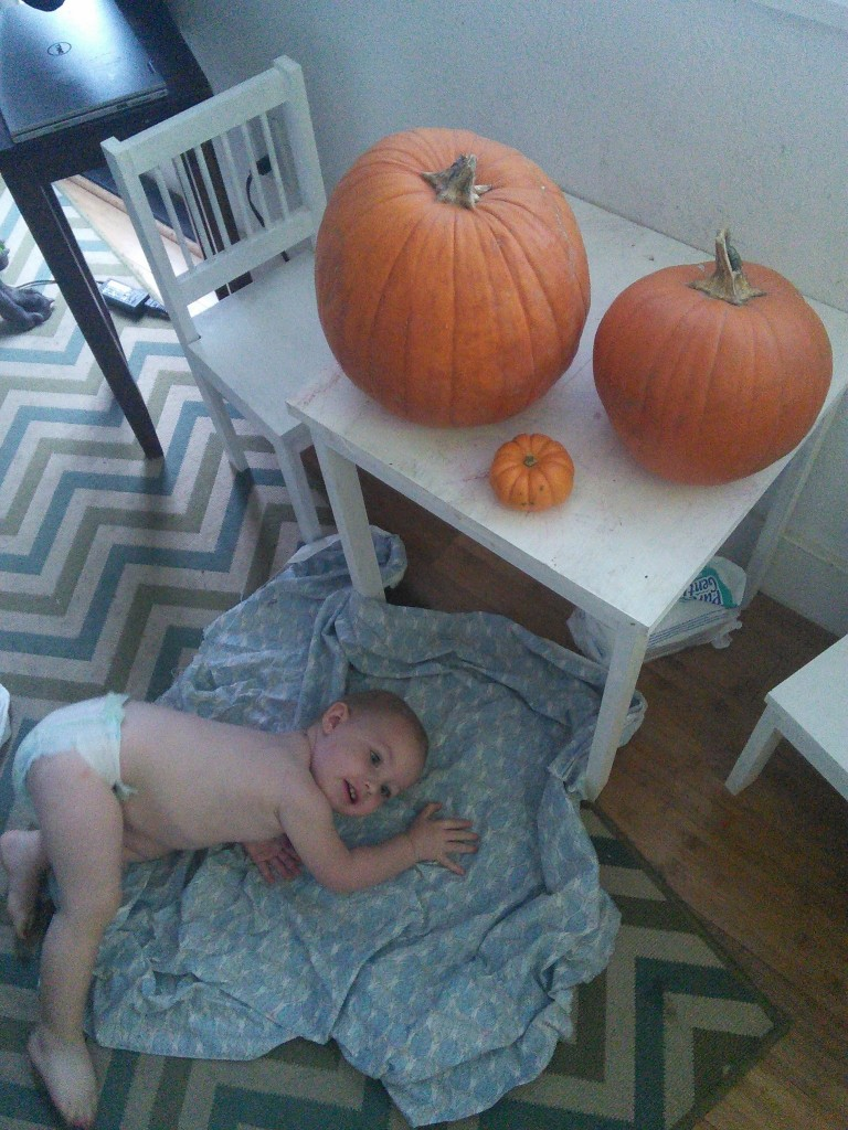 This is how Hazel carves pumpkins :)  We asked her to get in the picture, this is what she did...