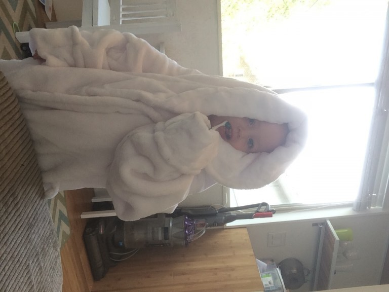 and wearing her moms robe