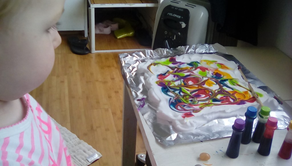 Hazels art project, it was fun, Shaving cream, food color and a stick to mix it around.