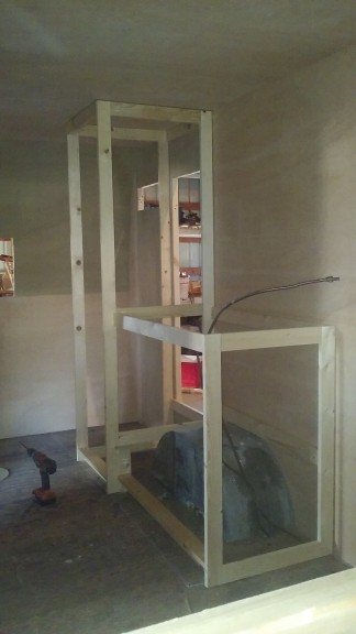 the fridge will be in the tall cabinet in back