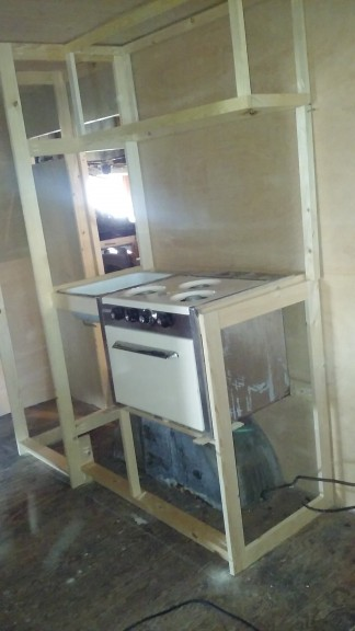 Sink/oven and upper cabinets above