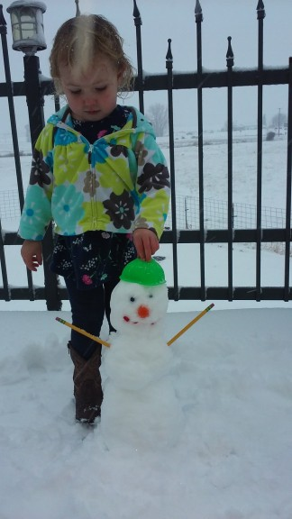 they made their first snowman too, 'Minnie' with pencils for arms!