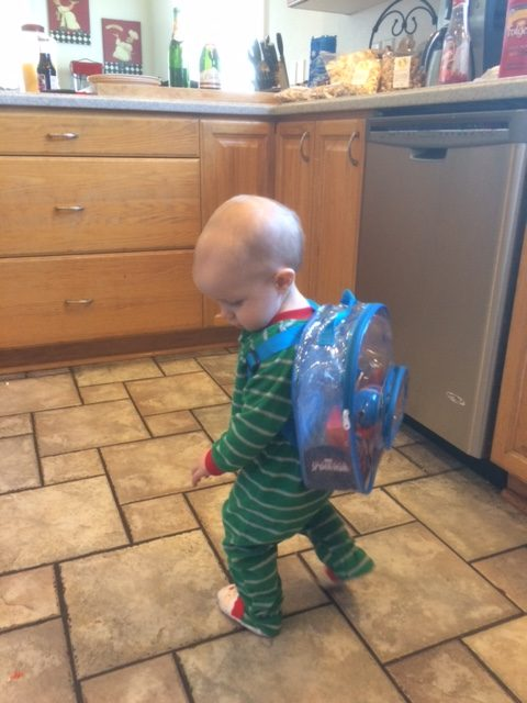 Loves his new fishing pole backpack