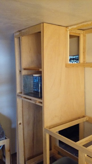 facing the cabinets
