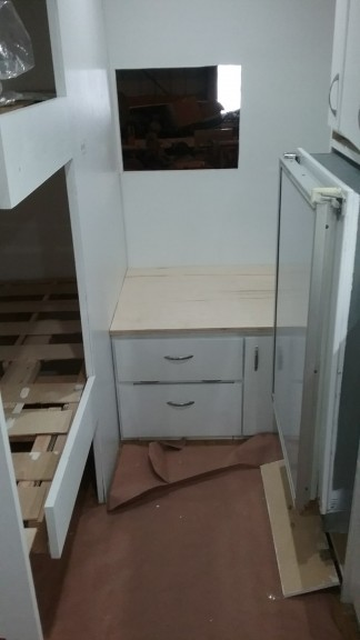 cut the millwork tops to size.  Once we get out glitter potty this will be our potty (there will be a curtain for privacy)