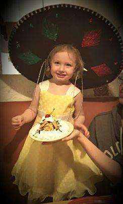 Her first fried ice cream and hat combo :)