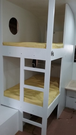 the finished bunks with their storage bins (in back)