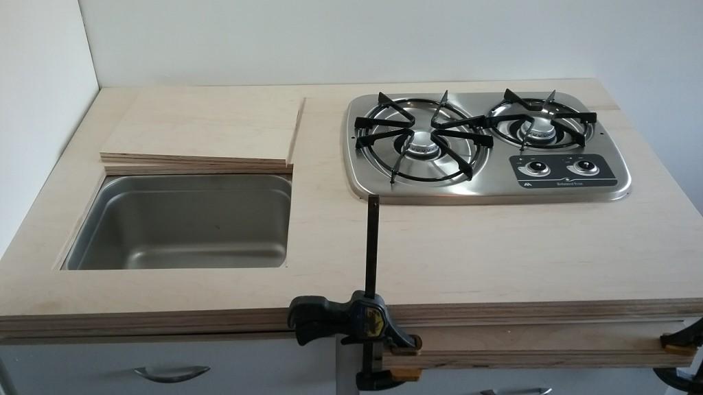 undermount sink with a custom cutting board top.