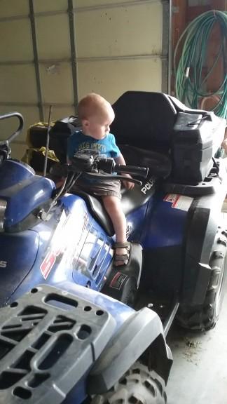 Miles likes the four wheeler