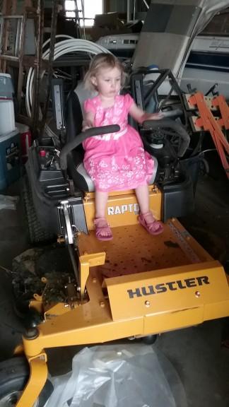 Hazel likes the lawn mower