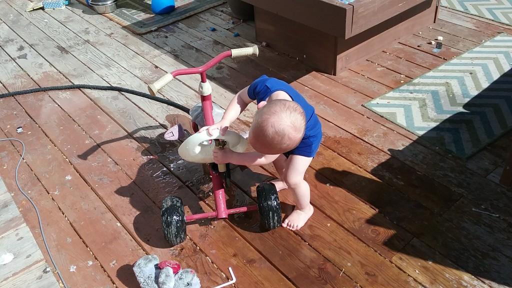miles LOVES washing his bike up...